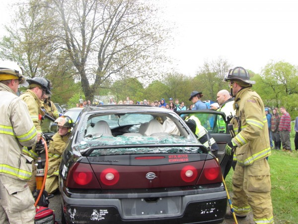 Rockland firefighters participate in the Every 15 Minutes program, simulating the extrication of victims from a car crash at Oceanside High School East in Rockland on Wednesday morning.