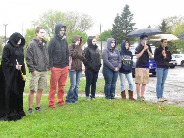 Oceanside High School East students, including one dressed as the grim reaper, watch the Every 15 Minutes program on Wednesday morning in Rockland.