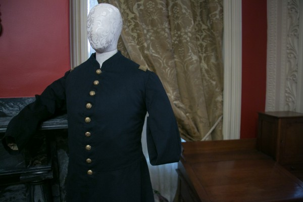 The uniform of a 'one sleever,' made for a civil war soldier who has had a limb amputated, is on display in the parlor room of the Bangor museum on Thursday. 'Bullets and Bandages' is a new exhibit at the museum that focuses on the weapons and medical practices of the Civil War.