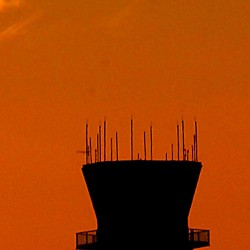 A small private plane passes over the control tower at Bangor International Airport  at sunset Wednesday.