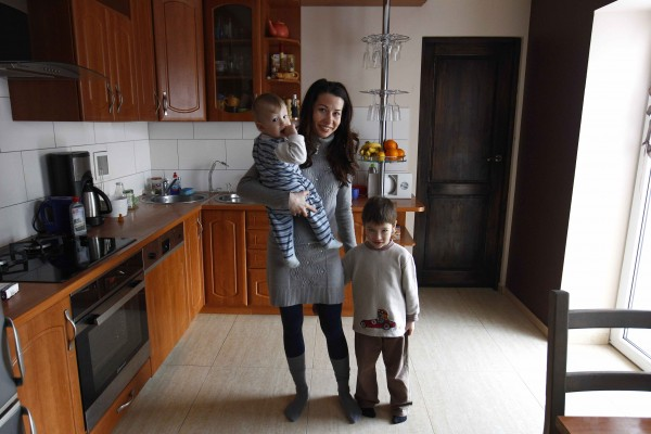Anna Pilsniak and her sons Micheasz and Nathan are photographed in their house in the village of Neu Rosow, Germany, located near the Polish border April 6, 2013.