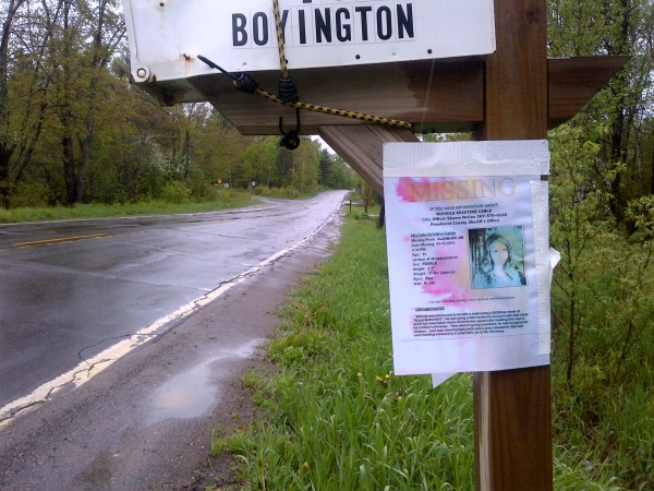 A missing person poster for 15-year-old Nichole Cable, a local girl missing since Mother's Day, hangs on a mailbox near the junction of Route 221 and Pushaw Road on Monday.