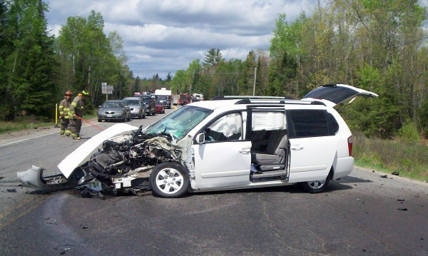 Two dogs jumping into the front seat of this van distracted the driver and caused an accident on Route 116 in Lincoln on Tuesday.
