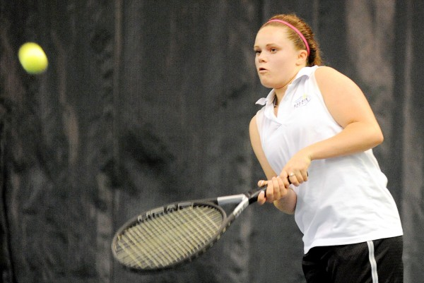 Sarah Smith of Calais returns a shot during her first-round match against Amber Pritchard of Winthrop during the state singles tennis tournament in Portland on Saturday. Pritchartd won 7-6(5), 6-4.