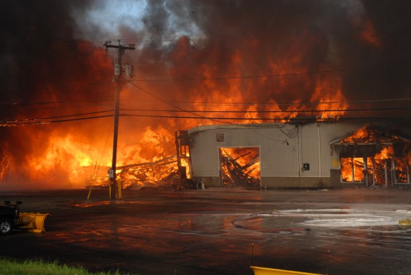 Flames engulf the Valley Auto GMC dealership in Fort Kent last October. Crews from seven St. John Valley fire departments were unable to save the structure which was totally involved when they arrived. They were able to protect nearby buildings and no injuries were reported.