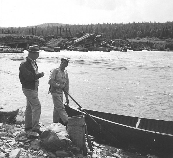 Outdoorsmen unload gear in front of Long Lake Dam on the Allagash Wilderness Waterway in the 1950s.