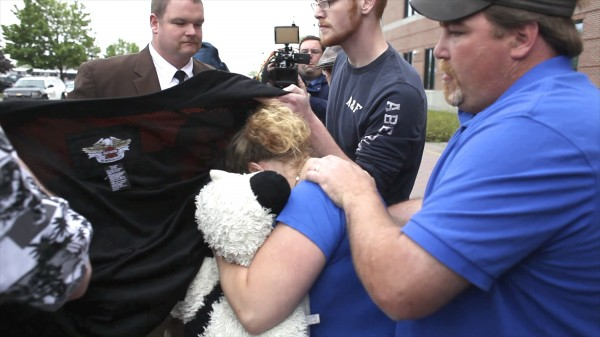 Kristine Wiley (from left), mother of Nichole Cable, and her husband, Jason Wiley, leave the Penobscot Judicial Center after Kyle Dube, the 20-year-old charged with murder in the death of Cable, made his first court appearance Wednesday in Bangor
