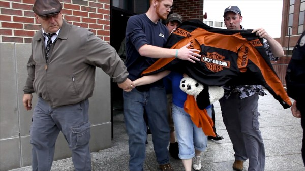 Kristine Wiley, mother of Nichole Cable, is covered by a jacket while leaving the Penobscot Judicial Center after Kyle Dube, the 20-year-old charged with murder in the death of Cable, made his first court appearance Wednesday in Bangor.