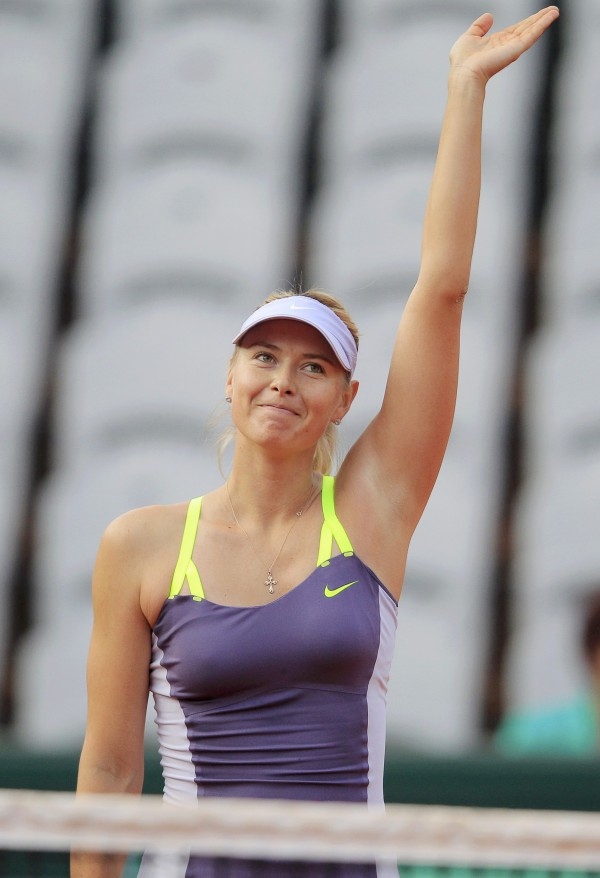 Maria Sharapova of Russia celebrates defeating Hsieh Su-Wei of Taiwan during their women's singles match at the French Open tennis tournament at the Roland Garros stadium in Paris May 27, 2013.