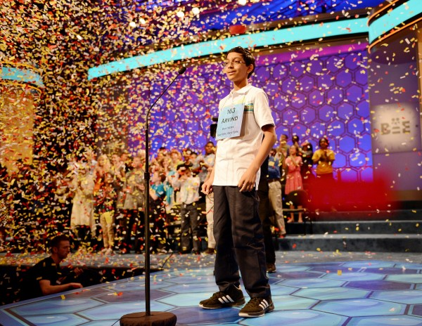 Scripps National Spelling Bee winner Arvind Mahankali of Bayside Hills, New York, stands under a shower of confetti after he spelled &quotknaidel&quot to win this year's Bee in National Harbor, Maryland, Thursday, May 30, 2013.