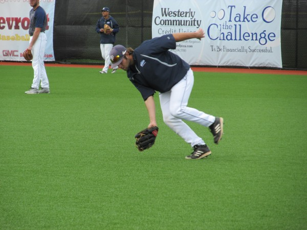 Outfielder Scott Heath of the University of Maine scoops up a ground ball while taking pregame warmups for Sunday's America East baseball title game against Binghamton University at Kingston, R.I.