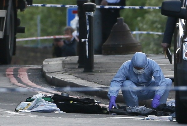 A police forensics officer investigates a crime scene where one man was killed in Woolwich, southeast London on Wednesday. British Prime Minister David Cameron has called a meeting of his government's emergency Cobra security committee after the killing of a man in south London.