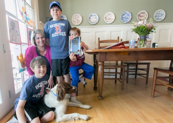 Sarah Smiley poses with her three sons, from left to right, Owen, Ford and Lindell, and her newly published book &quotDinner with the Smileys.&quot Smiley and her sons began inviting a guest join them for dinner at their Bangor home to fill in her husband's seat during his year-long military deployment. Over the year, the Smiley's guest list grew to include celebrities, professional athletes and U.S. senators. Smiley recounts the family's experience in the book.