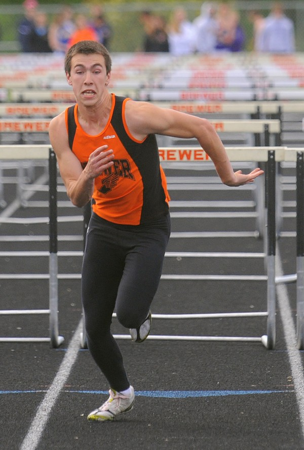 Brewer's Jeremy Bissell wins the boys 110 high hurdles during the PVC Class B Track and Field Championship in Brewer Monday. Bissell's time was 15.27 seconds.