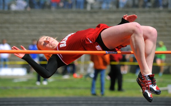 Bangor's Grace MacLean clears the five foot two inch height in the girls high jump during the PVC Class B Track and Field Championship in Brewer Monday. MacLean won the event and also won the girls' 110 meter hurdles.