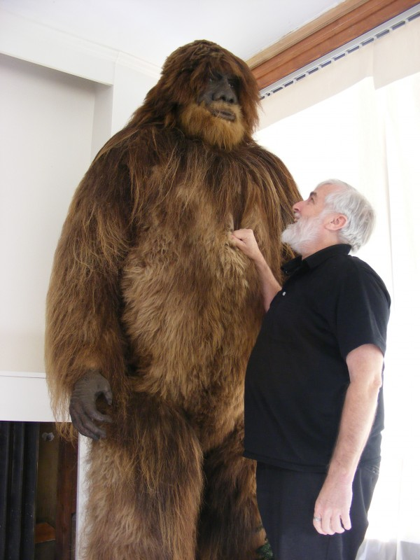 Loren Coleman examines a  Bigfoot sculpture at his museum in Portland in 2009.