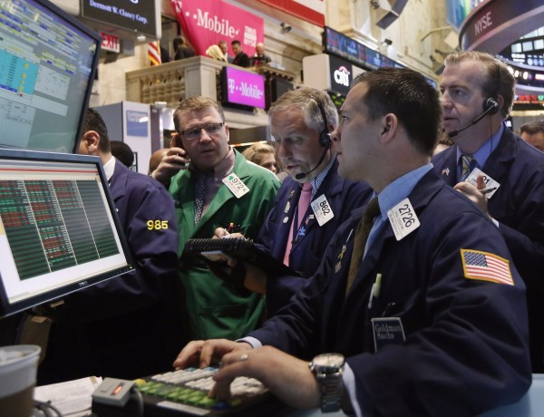 Traders work on the floor at the New York Stock Exchange, May 1, 2013.