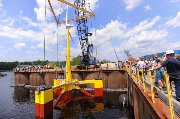The VolturnUS 1:8 is the first offshore wind turbine that launched in North America will be towed down the Penobscot River as the weather allows and it will be moored in the East channel of the Penobscot Bay near Castine.
