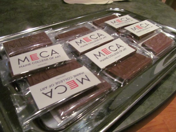 One of the first places Maine College of Art students saw their school's new logo Friday was on chocolate bars handed out at a news conference to unveil the mark. The logo will soon appear on the college's Congress Street sign, website, T-shirts and other paraphernalia.