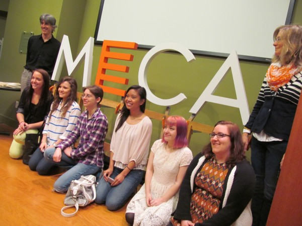 Maine College of Art students Hannah Sherwood, Sarah Mohammadi, Carlin Soos, Klarizza Kruz, Nicole Holmes and Sabrina Volante kneel in front of the institutional logo they helped design and document over a three-day workshop with faculty members Charles Melcher and Margo Halverson, standing, Friday. Other students on the design team not pictured are Kaitlin Callander, Lucy Henson, Dan Heutz and Celia Packard.