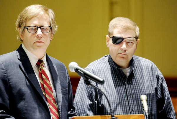 Michael Callahan (right) appears in Androscoggin County Superior Court with his attorney Jim Howaniec in March 2013.