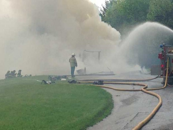 A home at 185 Verrill Road in Minot was destroyed by fire Friday afternoon. The home, which is owned by Michael Callahan, was the site of a police standoff last December.