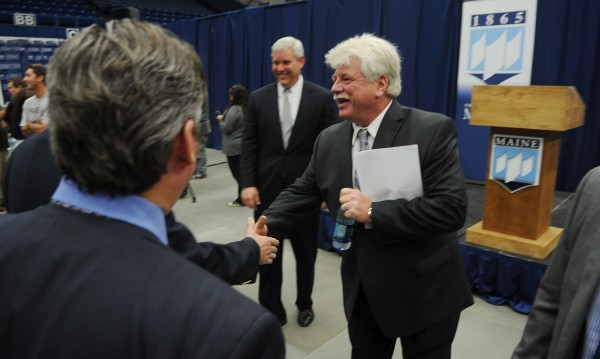 Newly hired head hockey coach Dennis &quotRed&quot Gendron shakes hands and meets members of the UMaine staff at Alfond Arena in Orono on Tuesday.