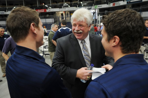 Newly hired head hockey coach Dennis &quotRed&quot Gendron, center, talks with UMaine hockey players, Jon Swavely, left, and Brice O'Connor at Alfond Arena in Orono on Tuesday.