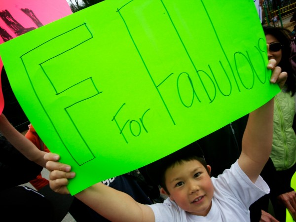 Henry Bibeau, 7, holds a sign outside Hall Elementary School in Portland Thursday afternoon at an impromptu support rally in the wake of the school's &quotF&quot rating by the governor.