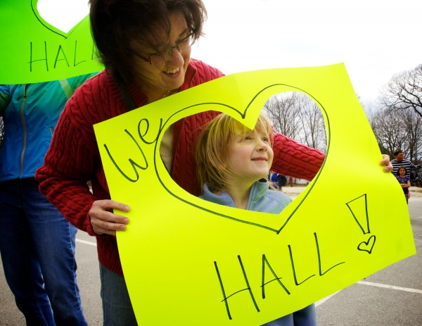 Julie Wagner holds a sign with her daughter, Libby, 6, outside Hall Elementary School in Portland Thursday afternoon at an impromptu support rally in the wake of the school's &quotF&quot rating by the governor.