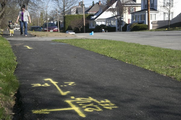 Flags and markings on the streets and sidewalks of Boutelle Road in Bangor indicate underground natural gas lines.