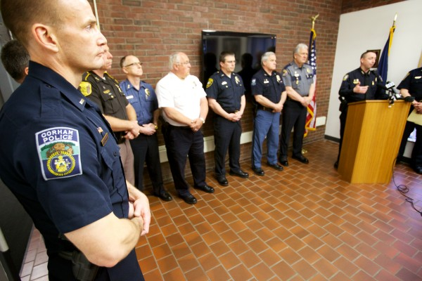 Gorham police Lt. Christopher Sanborn (left) listens with other southern Maine police personnel as Portland Police Chief Michael Sauschuck speaks in opposition to LD 660, which proposes to abolish Maine's concealed weapon permitting process.