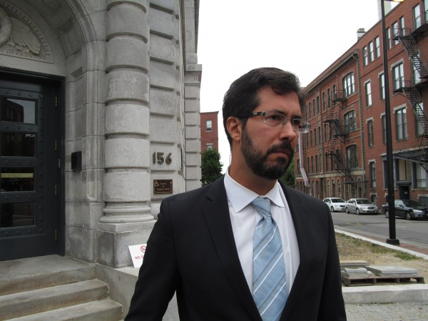 Zachary Heiden, legal director of the American Civil Liberties Union of Maine and attorney representing political consultant Dennis Bailey, addresses reporters outside the federal courthouse Friday, Sept. 21, 2012, after a hearing before U.S. District Court Judge Nancy Torresen.