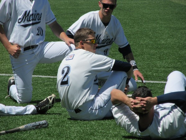 Mike Fransoso (2) of the University of Maine enjoys a light moment with teammates prior to last Saturday's game against UMBC in Orono on May 21. The Black Bears lost the America East championship to Binghamton University 4-0 on Sunday.