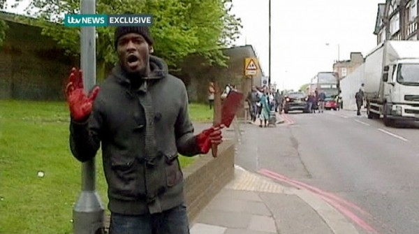 A man with bloodied hands and knives speaks to a camera as he appears in a still image from amateur video that shows the immediate aftermath of an attack in which a man was killed in southeast London on Wednesday. A man was hacked to death in a street near an army barracks in London on Wednesday in what Prime Minister David Cameron said appeared to be a politically motivated attack.