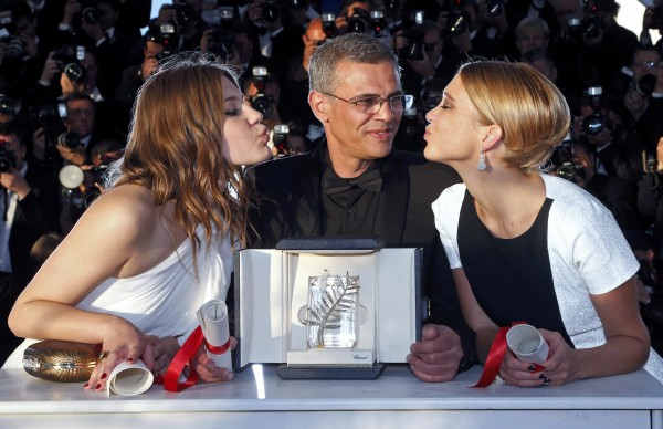 Actresses Lea Seydoux (right) and Adele Exarchopoulos (left) pose with director Abdellatif Kechiche (center) after he received the Palme d'Or award for the film &quotLa Vie D'Adele&quot at the closing ceremony of the 66th Cannes Film Festival in Cannes on Sunday.