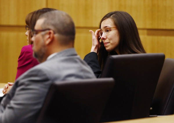 Jodi Arias reacts as a guilty verdict is read in her first-degree murder trial in Phoenix, Arizona May 8, 2013. Arias was convicted of first degree murder in the death of 30-year-old Travis Alexander, whose body was found in the shower of his Phoenix valley home in June 2008.