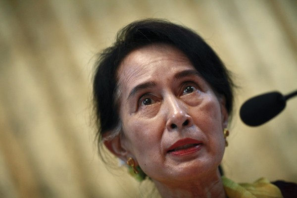 Myanmar's pro-democracy leader Aung San Suu Kyi talks to reporters during a news conference about Sydney University law faculty's constitutional workshop on Myanmar's reforms, at a hotel in Yangon May 10, 2013.