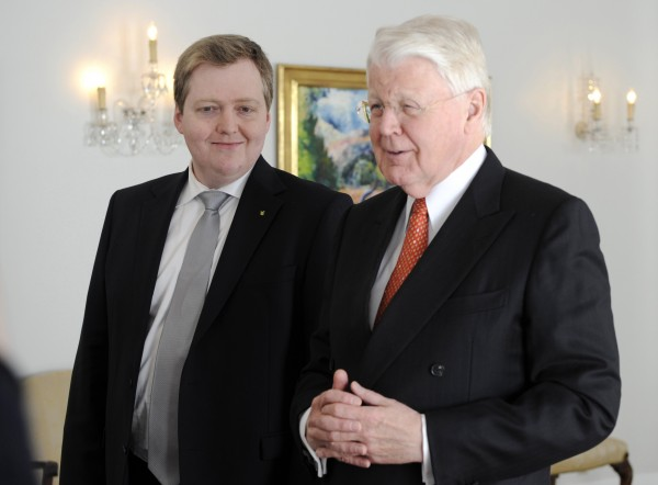 Sigmundur Gunnlaugsson (left), leader of Iceland's center-right Progressive party, listens to Iceland's President Olafur Ragnar Grimsson during their meeting in Reykjavik May 22, 2013.