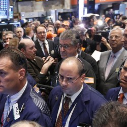 U.S. stocks climb as economic data offset federal spending cuts