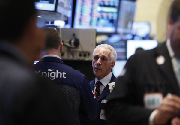 Traders work on the floor at the New York Stock Exchange May 13, 2013. Stocks ended flat on Monday, pausing after hitting record highs last week, but strength in healthcare issues helped to keep declines in check.