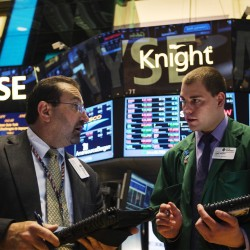 Wall Street ends near flat after recent highs; healthcare climbs