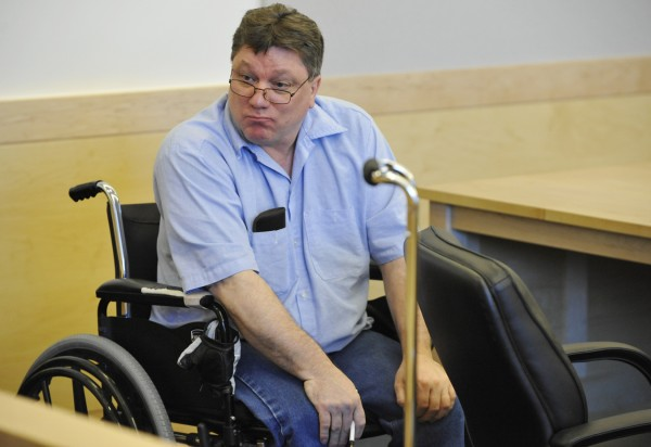 Seated in his wheelchair, Jeffrey Cookson turns toward the gallery at the close of a hearing for Cookson at Penobscot Judicial Center Wednesday, Aug. 31, 2011.
