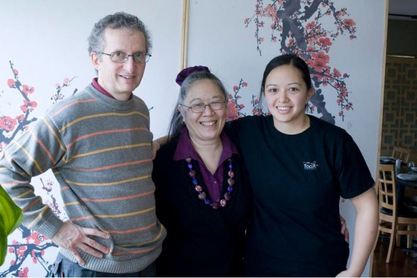 Tao Restaurant owners John, Cecile and Cara Stadler stand in their Brunswick establishment.