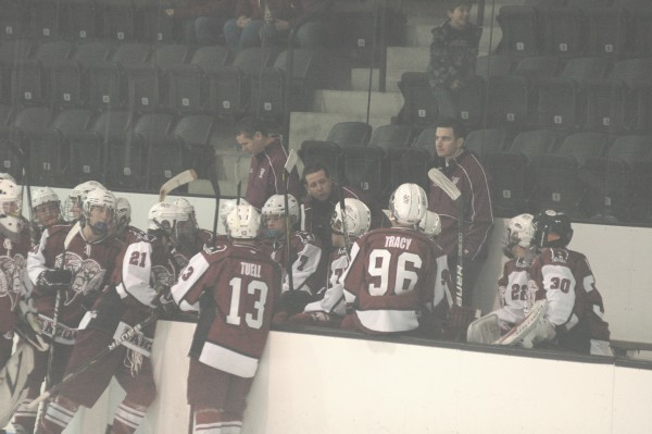 Interim Bangor High School boys hockey coach Quinn Paradis (center) talks to his team during a timeout during a game last December in Brunswick. Paradis has been named Bangor's full-time coach.