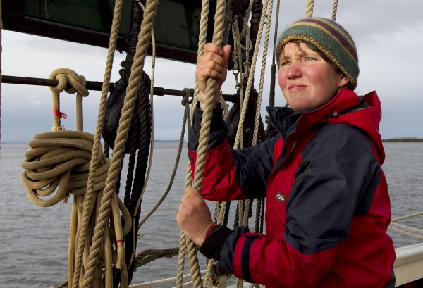 Veteran deckhand Jenny Baxter, 24, waits for the signal to start lowering a sailing on the schooner Mary Day, off the coast of Rockport, Maine.