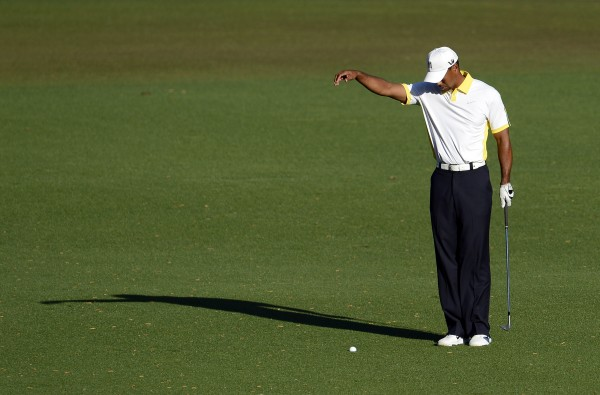 Tiger Woods takes a drop on the 15th hole during the second round of the 2013 The Masters golf tournament at Augusta National Golf Club.