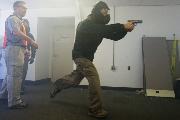 Portland police Sgt. Dan Hayden (left) puts an officer through a &quotlive shooter&quot drill Tuesday at the marine terminal on the state pier.
