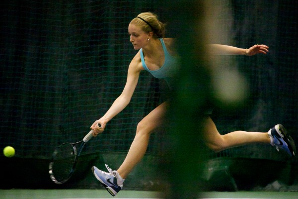 Julia Brogan of Falmouth High School returns a volley in a semifinal match at the Maine Principals Association Singles Tennis Championship at the Racket and Fitness Center in Portland on Wednesday.