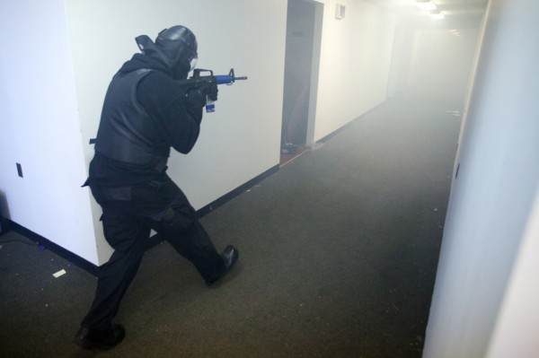 A Portland police officer goes down a smoke-filled hallway at the marine terminal on the state pier Tuesday during a &quotlive shooter&quot drill.